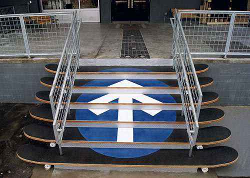 Rocketown concrete steps Deco-Crete Supply Ohio Concrete Decor Show 2011 Black Blue circle Arrow Logo