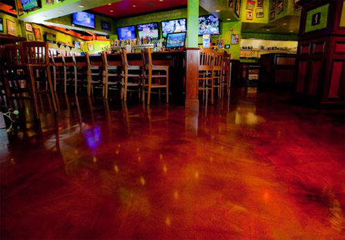 A floor that has been repaired with an overlay and color in 6,000 square feet of space