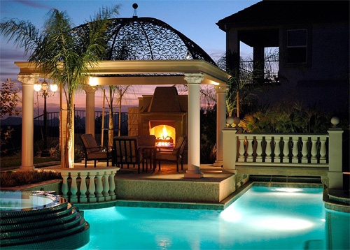 The central point of this pool deck is the fireplace.