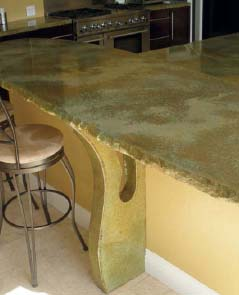 A concrete countertop at bar height with stools next to it.