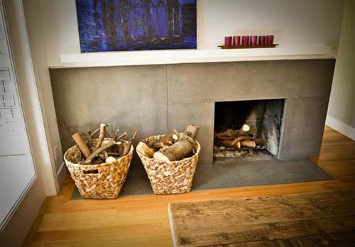 Wrap around concrete fireplace, baskets level to floor mantel.