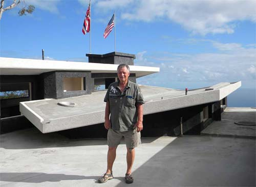 Rod Hadrian of SCIP system provider Hadrian Tridi Systems stands on the roof of the Hi'ilani EcoHouse.