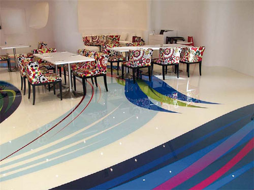 Installers applied large, colorful decals to the floors of the BoHouse Café to complement the restaurant's whimsical déco, of which these floral patterned chairs are just one example.