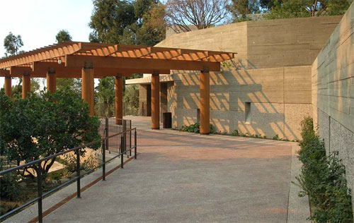 A pergola sits outside the museum at the top if this ramp.