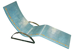 Teal concrete lounge chair with arms and orange accents.