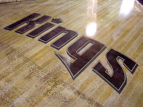 Sacramento Kings logo that has been embossed into a concrete floor by polishing, staining and engraving concrete.