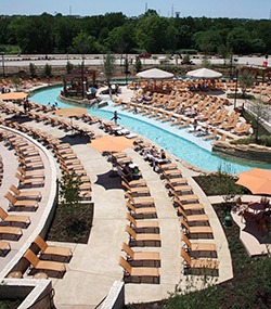On patios and pool decks at Paradise Springs water park, part of the Gaylord Texan resort in Grapevine, Texas, Lonestar Concrete Systems installed integrally colored concrete in a custom-blended buff shade and troweled in millet seeds for texture.
