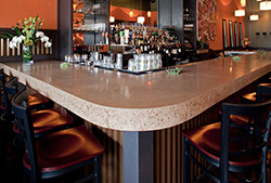 Sharply curved corner in a concrete countertop in New England hip bar. Photo by Sandy Agrafiotis