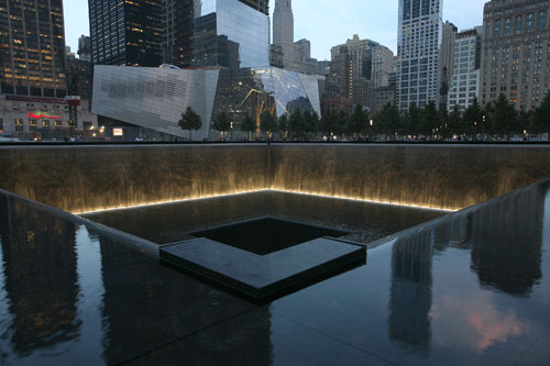 The National September 11 Memorial, which officially opened to the public Sept. 12, 2011, features a plaza with trees and twin reflecting pools, each nearly an acre in size that sit within the footprints where the North and South towers once stood.