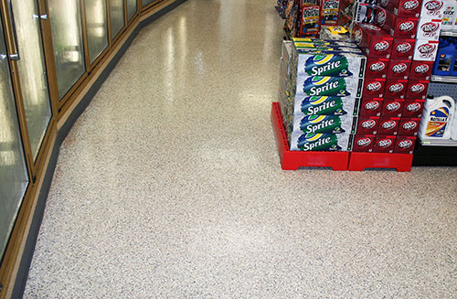 This floor features a double-broadcast quartz system. The client was looking for a decorative floor as well as a surface that was both impact- and slip-resistant.