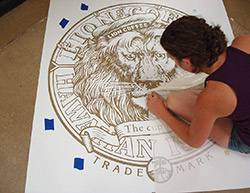 An installer pulls every little detail out of this stencil to prepare for the final colors.