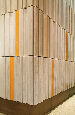 Concrete books line the walls at headquarters concrete decor - Decorative precast concrete wall panels ...