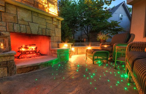 A hot knife is used to cut the ends of the fiber optic lights after the colored stamped concrete has cured.