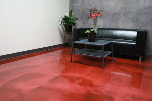 The showroom at Westcoat Specialty Coating Systems' headquarters in San Diego features the Liquid Dazzle metallic epoxy floor-coating system in Ruby. It was applied by company staff.