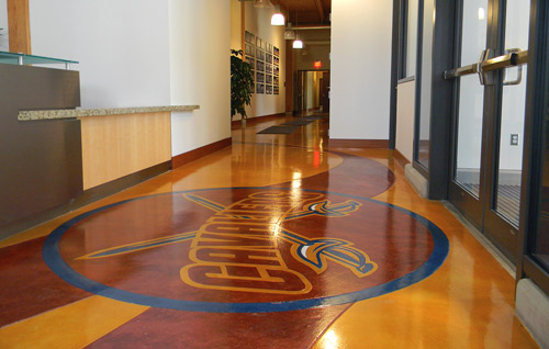 This floor at a Cleveland Cavaliers practice facility was colored with Düraamen's Lümiere epoxy in Brass, Bronze and Copper by Pat Maloy, PDM Concrete LLC, Avon, Ohio.