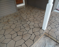 Concrete entry way to look like natural stone with darker grout lines.