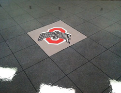 The Ohio State University logo was stenciled and stained onto this concrete floor.