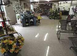 Entrance to a grocery store where decorative concrete was placed on the floor and sealed.