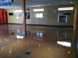 High-gloss concrete floor with a pillar in the middle.
