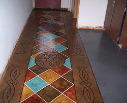 A concrete boarder in browns, reds, yellows and teals.