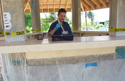 Jeffrey Girard mixes sealer to coat the finished cast-in-place bar top