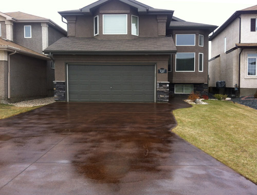 Randy Klassen, Winnipeg, Manitoba, grinds outdoors with equipment he bought for polishing inside. This is a driveway he ground and acid-stained.