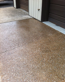 Chris Paisley ground and scarified this driveway in Louisville, Ky., to give the surface a more aggressive profile, then sealed it.