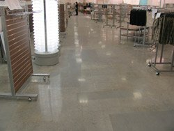 As seasoned contractors would expect, some of the polished floors in renovated stores contain irregularities like the patched sections seen here. Photo courtesy of S&S Concrete Floors Inc.