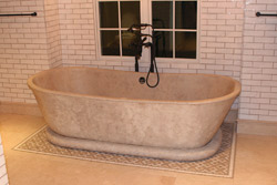 Many contractors use a densifier when constructing a concrete bathtub to reduce the porosity of the finished product.