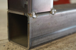 Make sure all four corners are properly tacked after squaring before running a full weld. This will ensure the steel's placement. If not tacked, the material will tend to bend towards the point of the weld, resulting in a very out-of-square bond. Usually, this cannot be fixed without breaking the weld and starting over.