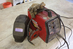 The basics to get started: flux-cored arc welder (with MIG conversion), welding gloves, welding mask (auto-darkening recommended) and magnetic squares.