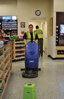 Mid Atlantic Floor Care employee Casey Elswick runs a Clarke Focus II autoscrubber at a Wawa convenience store in Midlothian, Va. Photo courtesy of Susan Wilkerson