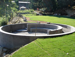 The two-level ceremony circle Brown built for them consists of a circular wall, a short set of stairs that connects the two levels, a half moon-shaped seating structure inside the circular wall and a lone bench next to the seating structure.
