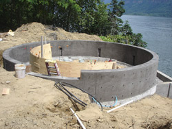Brown poured the 10-inch-thick circular wall using a 3,500-psi concrete mix colored with Davis Colors' Chameleon Mix-Ready dye system in Pewter, then moved on to constructing and pouring the half-moon seating structure, again using 3/8-inch-thick plywood pieces for the frame.