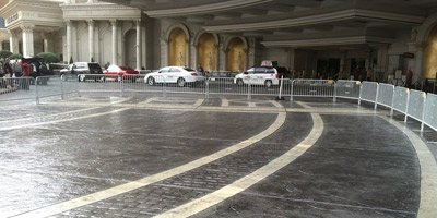 Like any concrete surface that leads to the front entrance of a major Las Vegas hotel, the driveway at the main valet area of Caesars Palace is subject to all kinds of wear and tear.