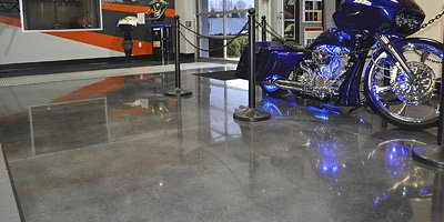 A concrete floor that was polished after the vinyl composite tile was removed.