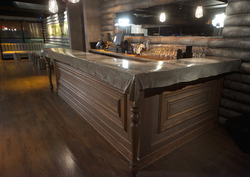 5Church a high end restaurant in Charlotte has a reception area concrete countertop mimicking a piece of fabric laying over a countertop.