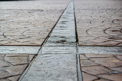 A close up look a the transition in colored stamped concrete.
