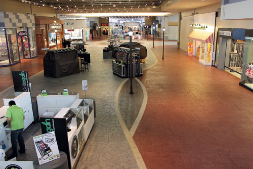 A Concrete Makeover In A Mall Covers Outdated Tile With