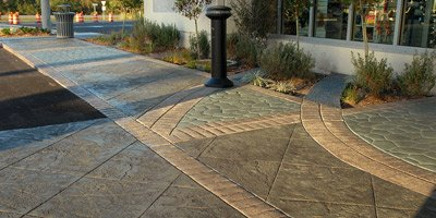 Stamped concrete entryway to a restaurant also acts as a passenger drop off.