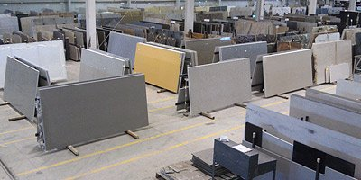 Move over marble, granite and engineered composites. With the popularity of concrete countertops on the rise, the time has come for mass-produced precast concrete slabs to enter into the fray.