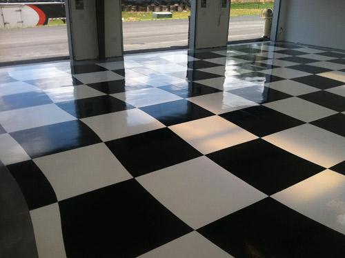 Checkered Flag Polyaspartic Garage Floor | Concrete Decor