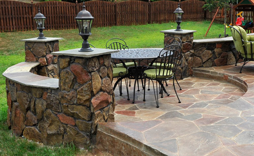 Captivating Stamped Concrete Backyard Patio With Individually Colored Concrete Stone.