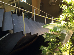Concrete steps with hand rails leading up.