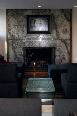 Fireplace surround that spans floor to ceiling.
