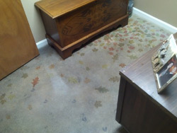 Acid stained and stenciled concrete floor with leaves