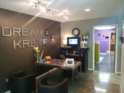 The main lobby of DreamKrete in Virginia showcases a cut, colored tile pattern under the desk, a cut and grouted stone pattern, and an Oriental rug pattern at the door. Photos courtesy of DreamKrete