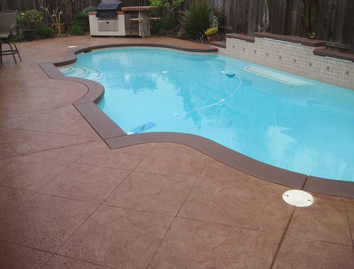 To restore this pool deck, Wayne Morse of AM Resurfacing, Elk Grove, Calif., stripped the original coating with NewLook's EasyStrip 2000 and cleaned it with a power washer. He applied NewLook's Original Solid Color Stain in Caramel, then Oak Translucent Color Enhancer to create a two-toned, antiqued finish. The bands are Original Solid Color Stain in Oak. Photos courtesy of AM Resurfacing, NewLook International Inc.