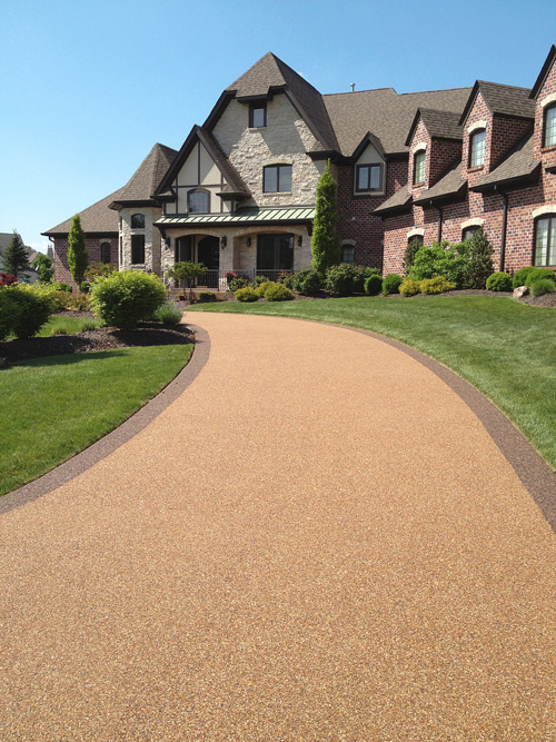 St. Louis Resurfacing Created This Residential Driveway Using McKinnon  Materialsu0027 River Rock. The