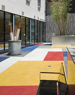 T.B. Penick & Sons Inc. created this vibrant San Diego courtyard with the help of white cement. Each section was seeded with an aggregate or glass material the same color as the integral shade. Photo courtesy of T.B. Penick & Sons Inc.